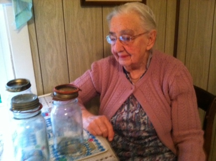 Mother saying goodbye to her canning jars before sending some of them to the Re-Use-it Shop
