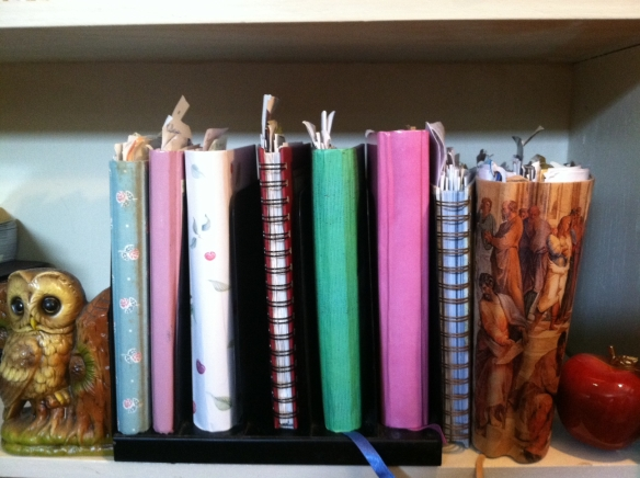 My stack of journals minus the fatter one on my nightstand