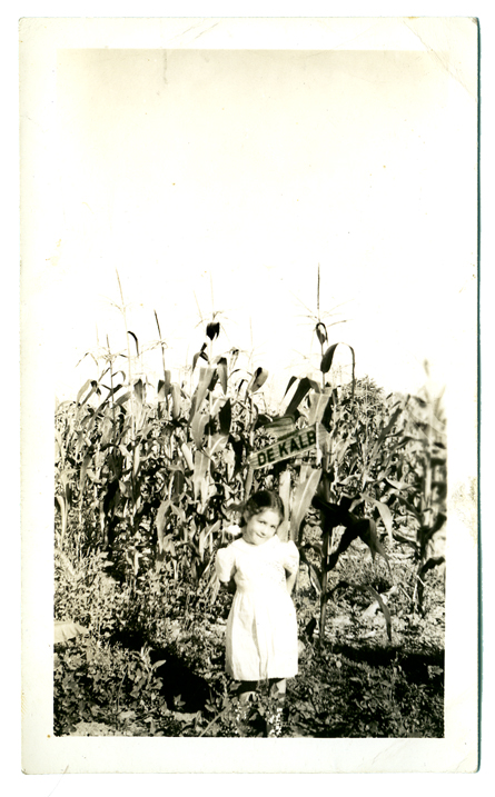 Proudly advertising DeKalb corn, no bonnet or bandanna