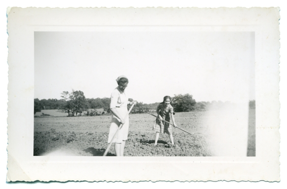 Aunt Ruthie with scarf and I hoeing in tomato field