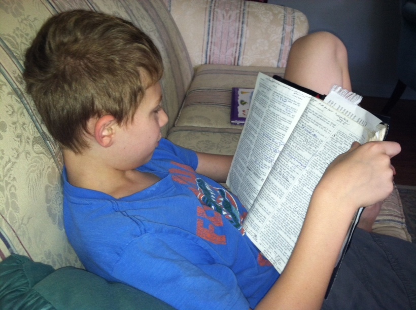 Patrick reading in Book of Luke