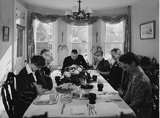Saying grace before carving the turkey at Thanksgiving dinner in the home of Earle Landis in Neffsville, Pennsylvania