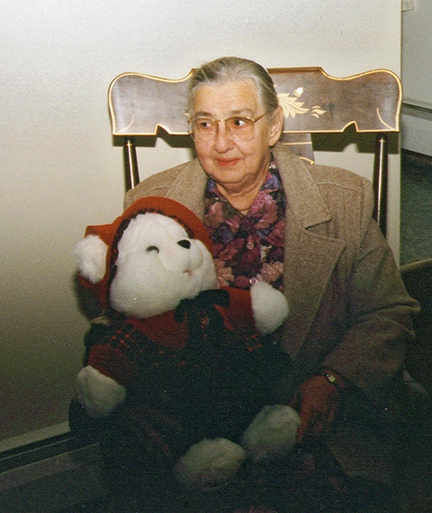 Mom with sheepish look holding teddy bear   1992