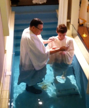 Rev. Bill Caverly baptizing Grand-nephew Patrick Dalton