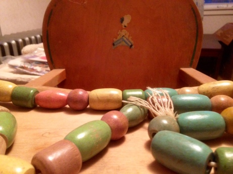 All of Mother's children and many of her grandchildren sat on this highchair and played with these wooden beads and blocks. We never played with plastic toys.