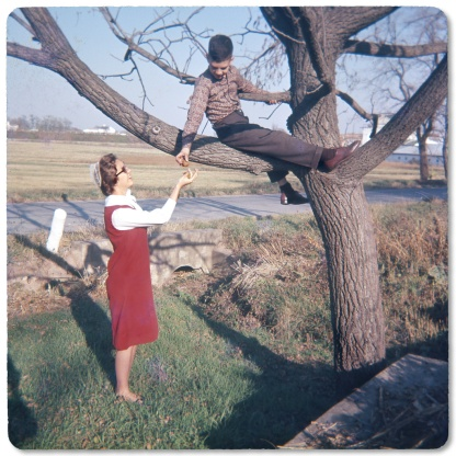 Mark handing walnuts to his sister Janice, 1964