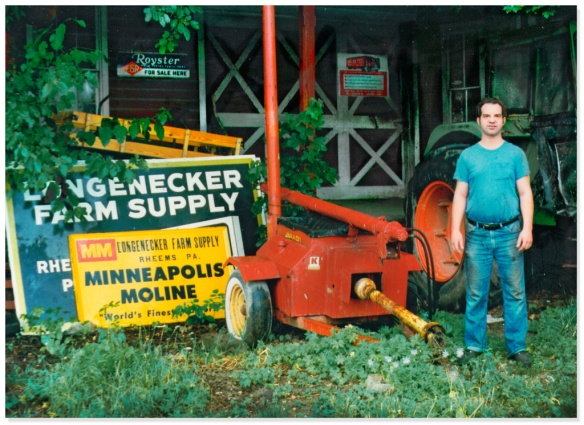 Mark in front of shop beside soybean extruder, 1984
