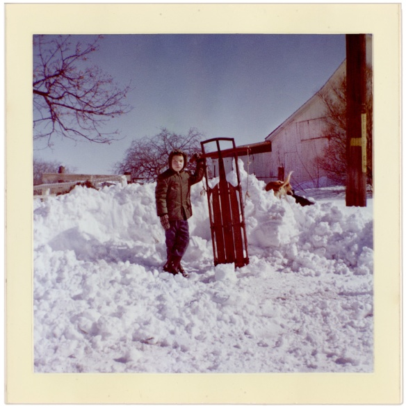 Brother Mark with sled and Skippy in the snow 1961