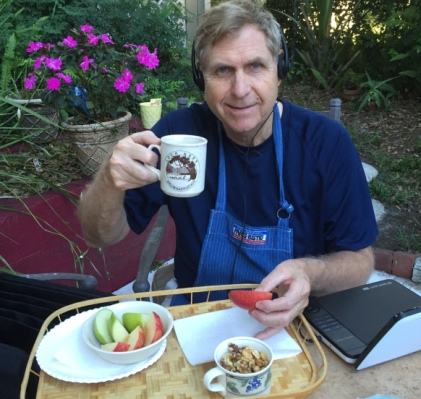 Cliff relaxes with coffee, snack and audio book in May before the frenzy began.