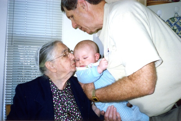 Mother kissing her great grandson Patrick, held by Grandpa Cliff