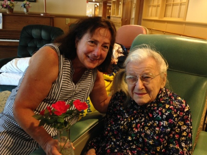 Niece Jean brings knockout roses for Aunt Ruthie now living at Landis Homes.