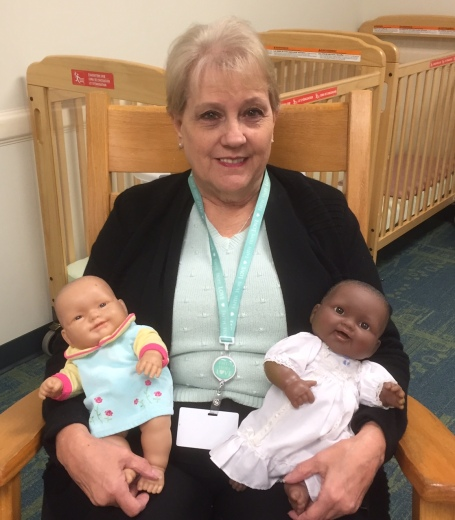 Friend and co-worker Gloria, who'd rather hold real babies!